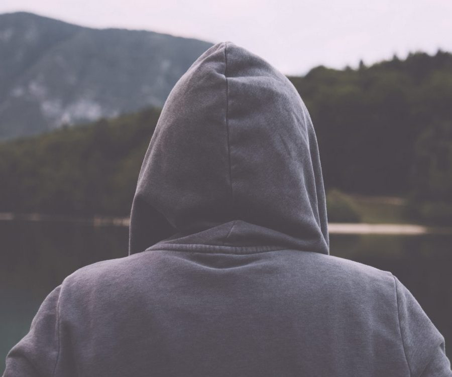 Gloomy sad woman standing by the lake